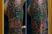 Green Skull Arm Tattoo
