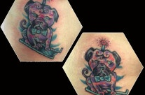 Two matching robot pug dogs on sleds, tattoed on two friends.